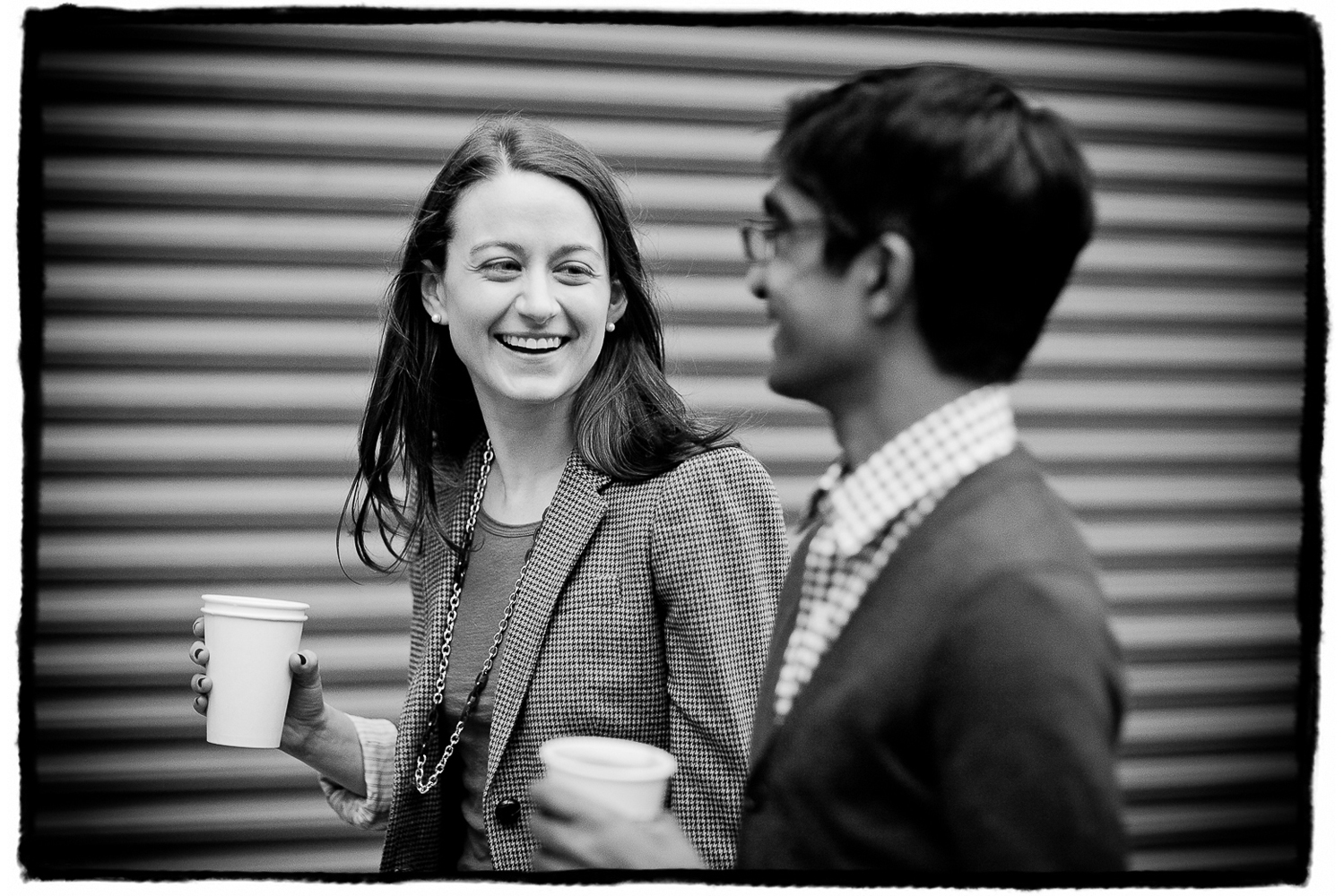 Engagement Portraits: Katie & Sharmilan walk and talk with coffee from their favorite cafe.