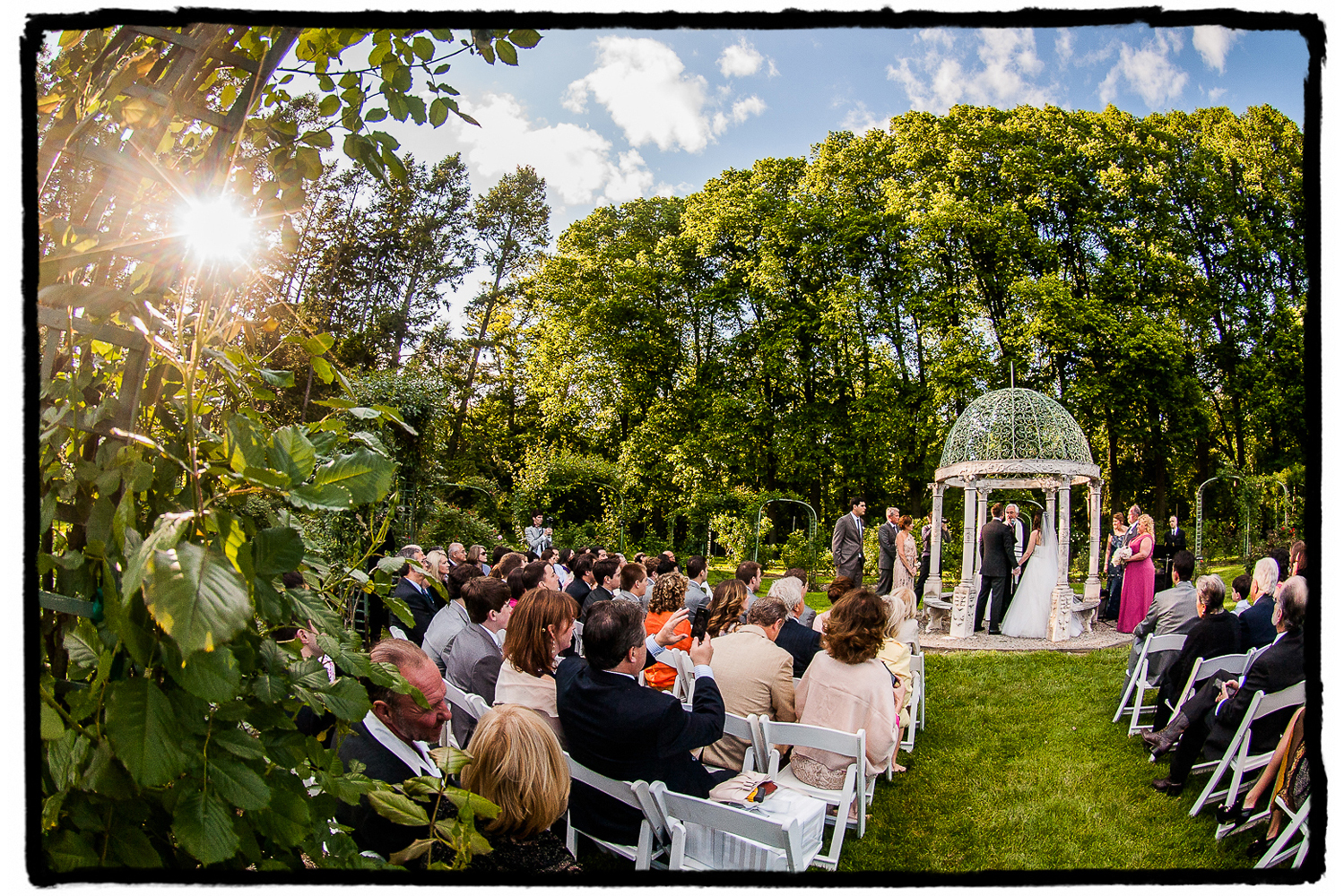 Michelle and Dan's summer ceremony in the rose garden gazebo at Lyndhurst Castle in Westchester NY.