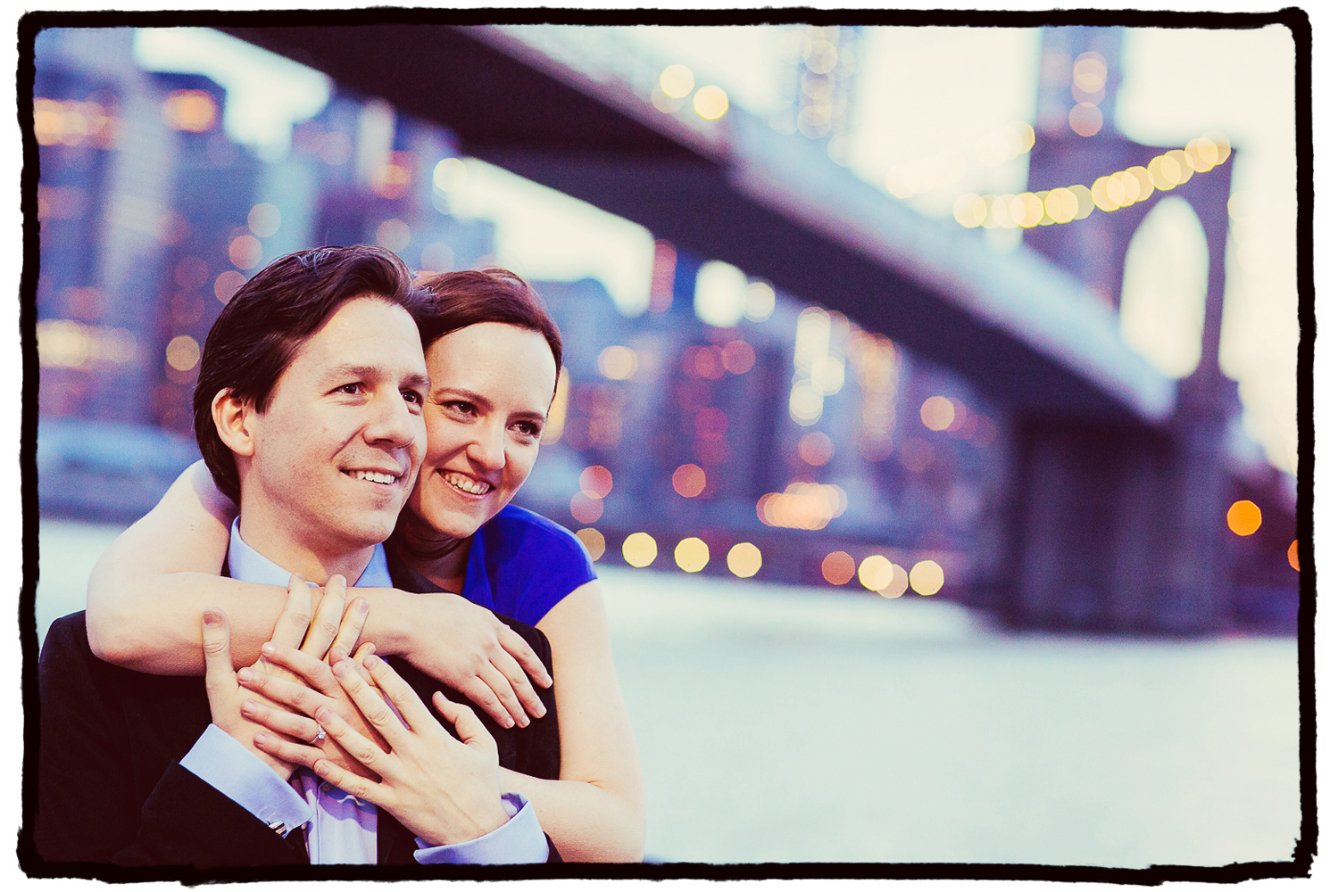 Engagement Portrait: Laura & Axuve enjoy the city skyline from Brooklyn Bridge Park.