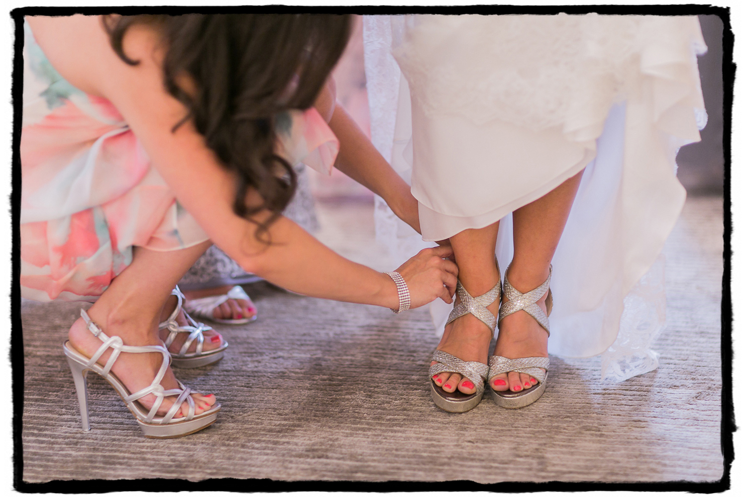 Rorie's bridesmaids help strap on her silvery Jimmy Choos.