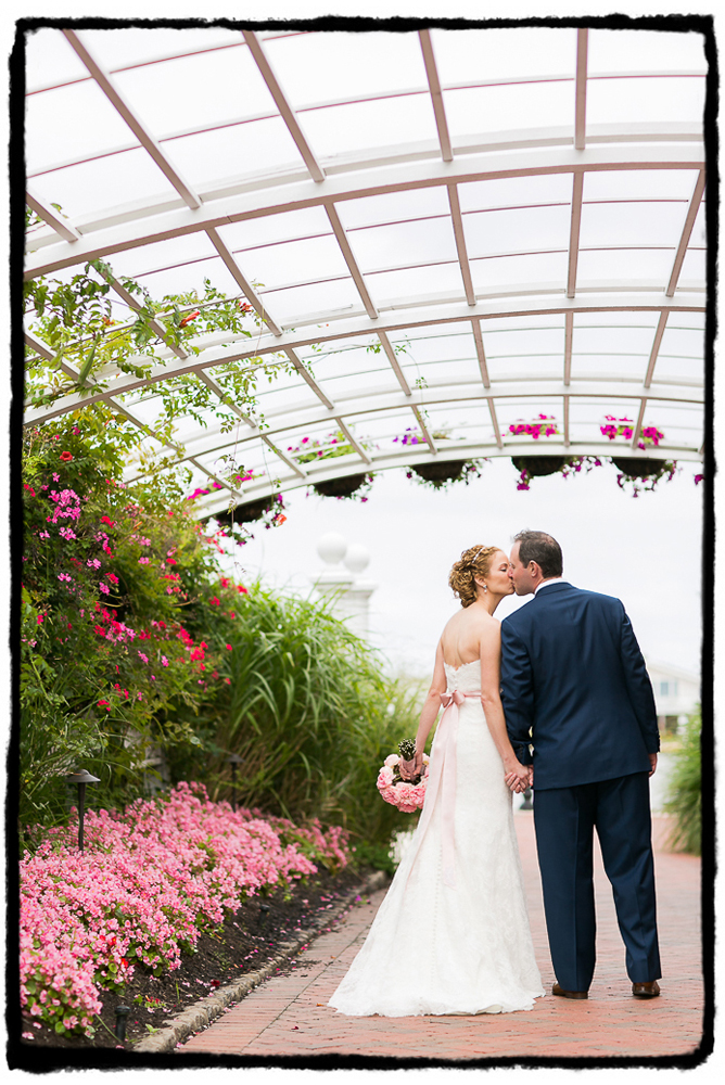 This little walkway at Bonnet Island Estate with soft pink flowers provided a beautiful framing device for a walking shot of Kelly and Scott.