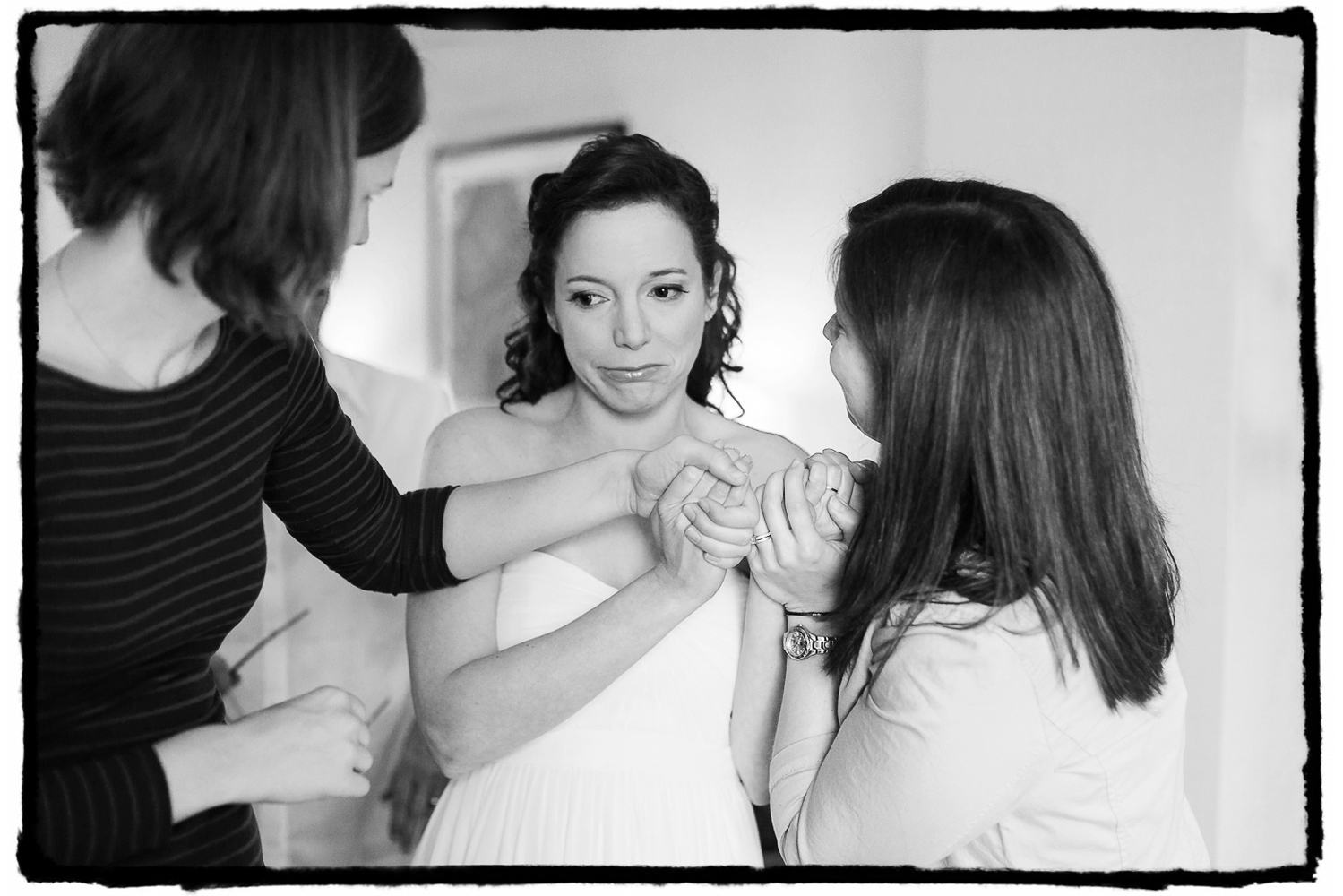 Julie shares an emotional moment with her bridesmaids as it hits her that this is really the day of her wedding at Battery Gardens.