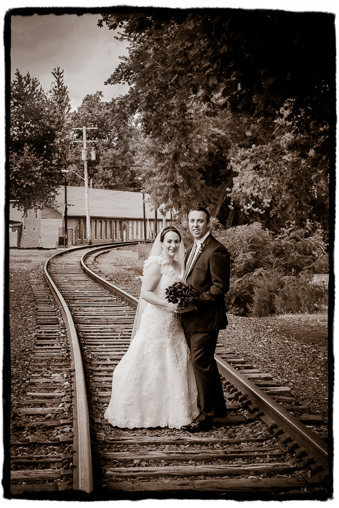 I love how this portrait on the abandoned railroad by the Roundhouse at Beacon Falls looks in Sepia tones.  Sometimes I prefer a straight black and white, but sometimes the warmth of that added touch of brown really fits with a wedding's style.