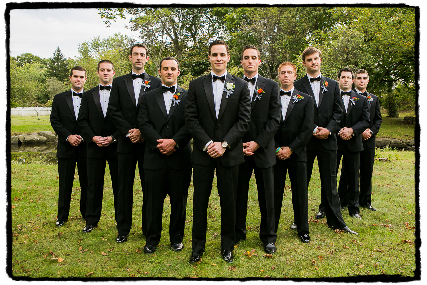 Mike and his groomsmen in black tie at the park in Greenwich, CT.