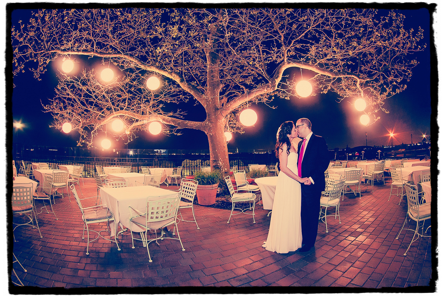 I love to sneak outside for a night portrait with couples if they are game to leave the reception for a quick few minute at some point.  Julie and Ryan are shown on the patio at Battery Gardens with it's lovely lanterns.