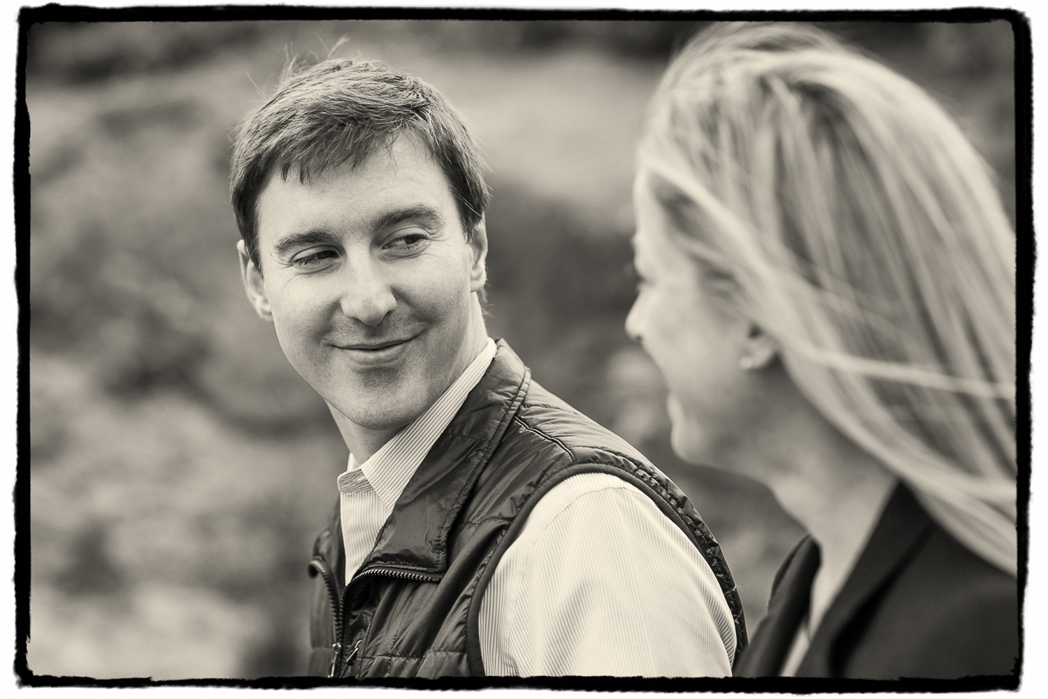 Engagement Portraits: Tim gives Noelle a loving look as they walk through Central Park.