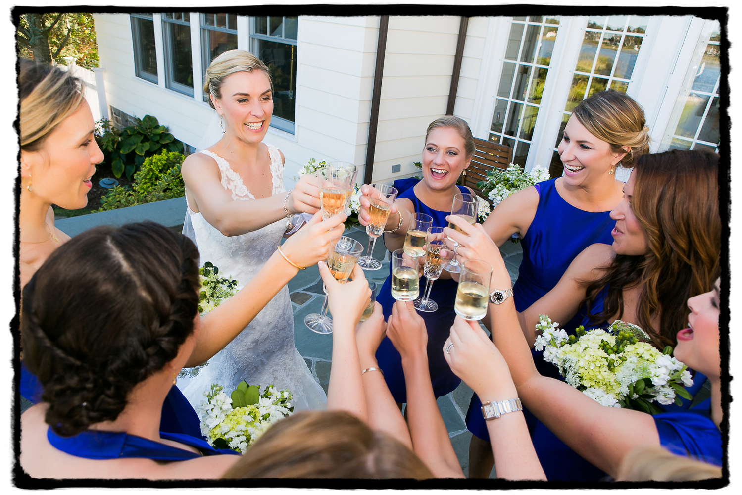 Carrie and her bridesmaids share a toast on her parents' back deck before heading to the wedding at Belle Haven Club in Greenwich, CT.