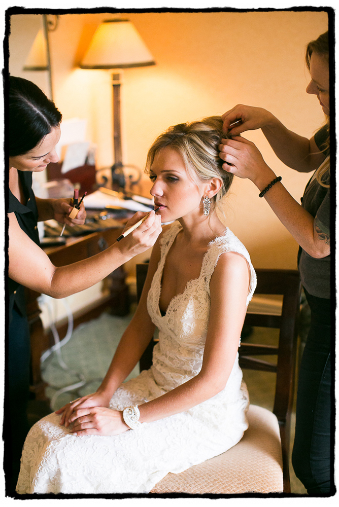 Devin's hair and makeup gets a final touchup after putting on her wedding gown in Greenwich, CT..
