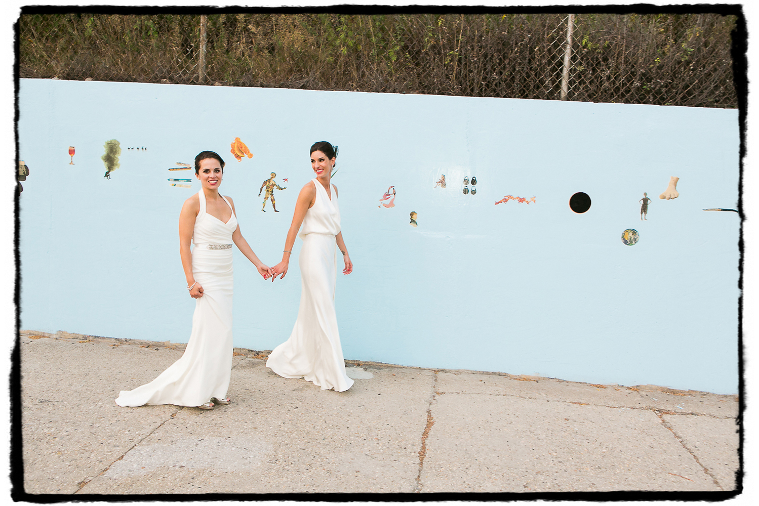 Lara and Nicole were married at The Green Building in Brooklyn and on that very day an artist was painting this particular mural behind them.  It's gone now but will live on in their wedding photographs.