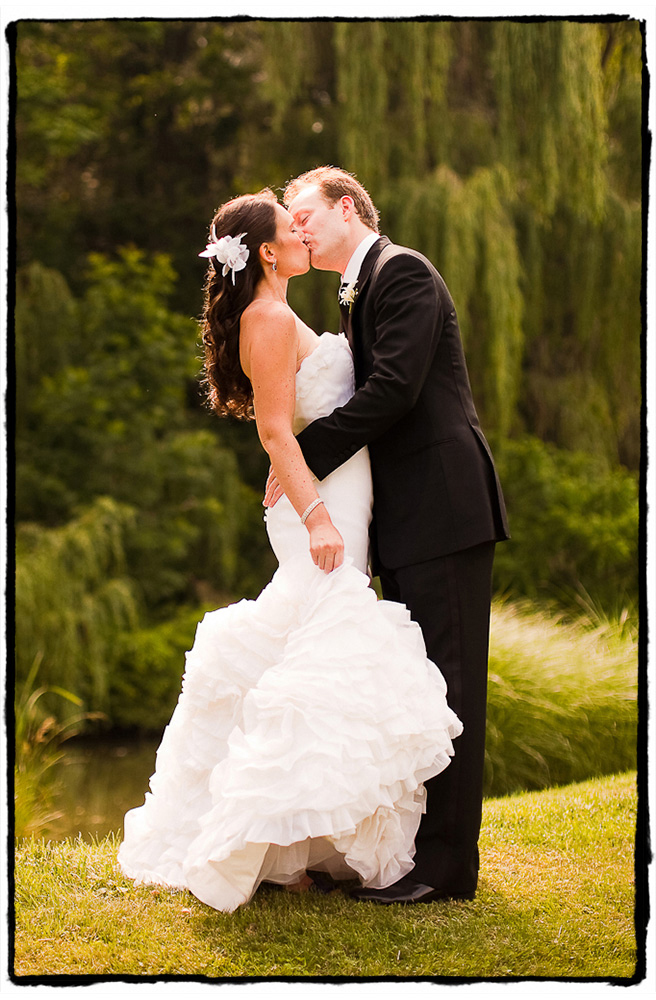Alex and Michele share a sweet kiss in front of the weeping willows at Buttermilk Falls in the Hudson Valley.