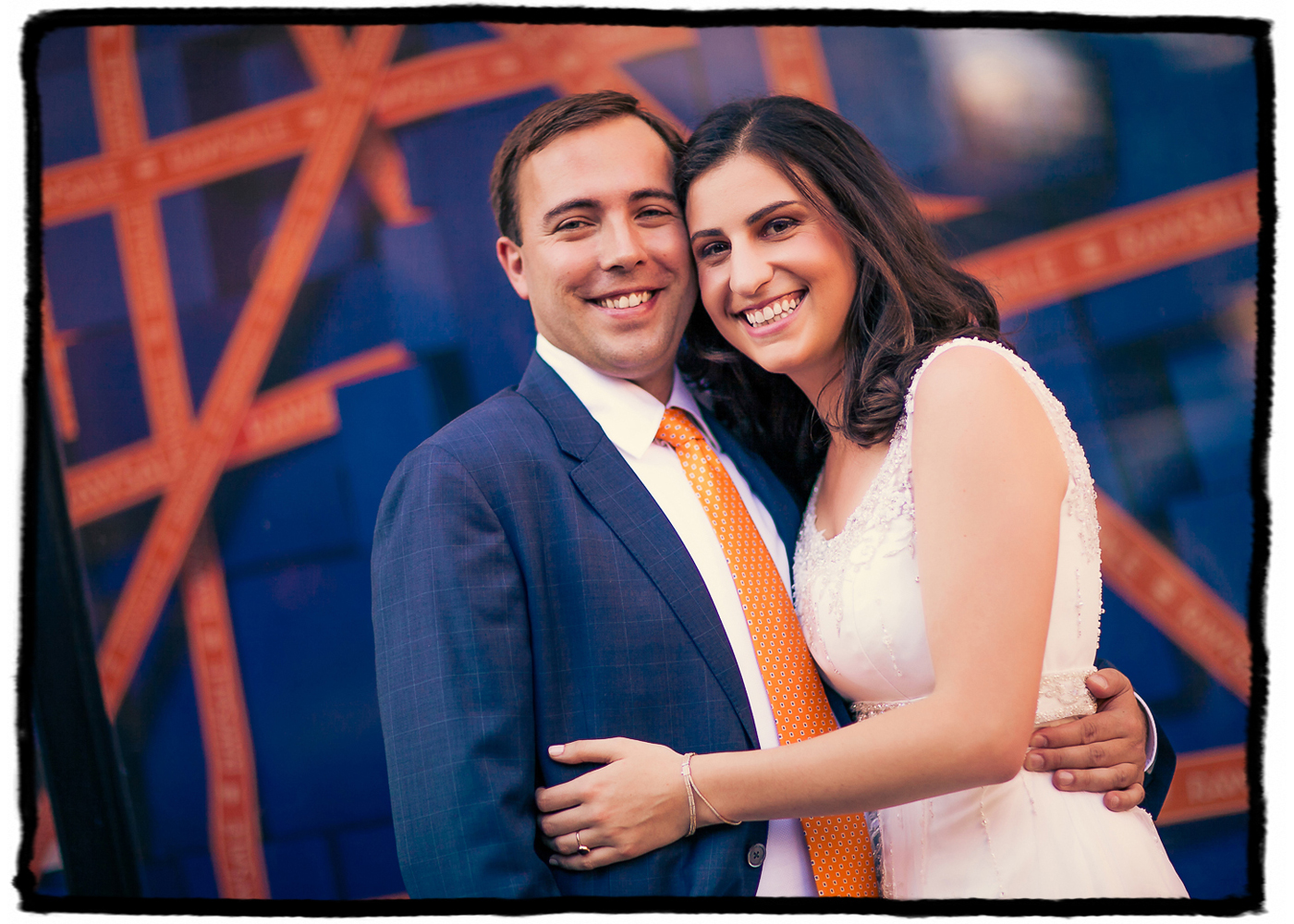 Marisa and Nolan were married at Housing Works Bookstore in Soho.  We walked around the neighborhood and when I saw the blue and orange tones on this signage and how they would match the groom's suit and tie I just had to shoot them with it.