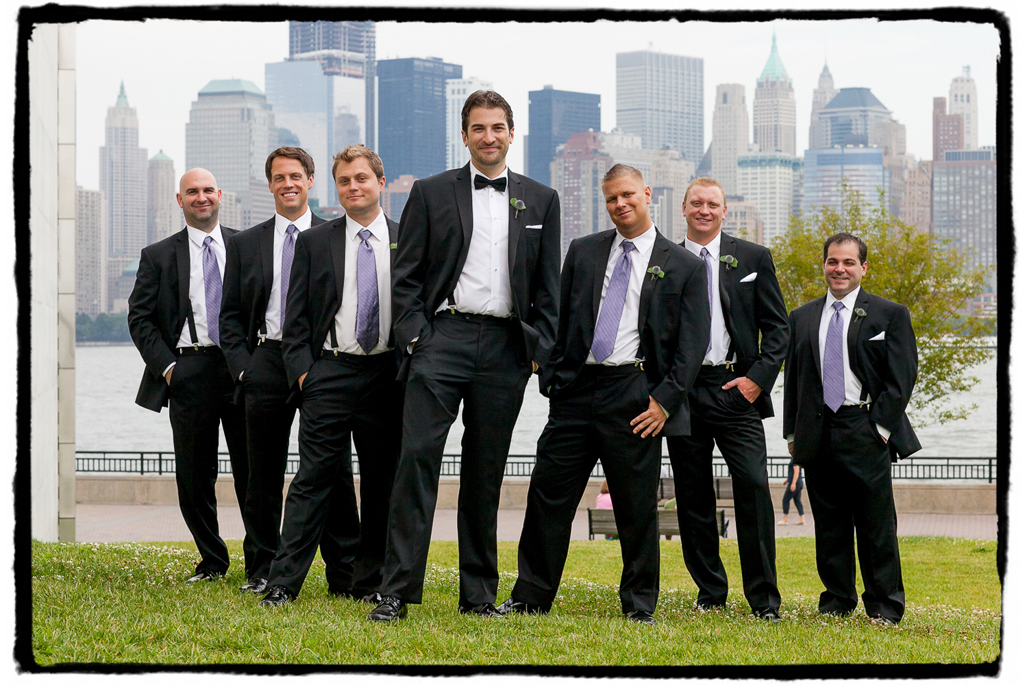 Rich and his groomsmen strike a pose with the NYC skyline in the background at Liberty House in Jersey City.