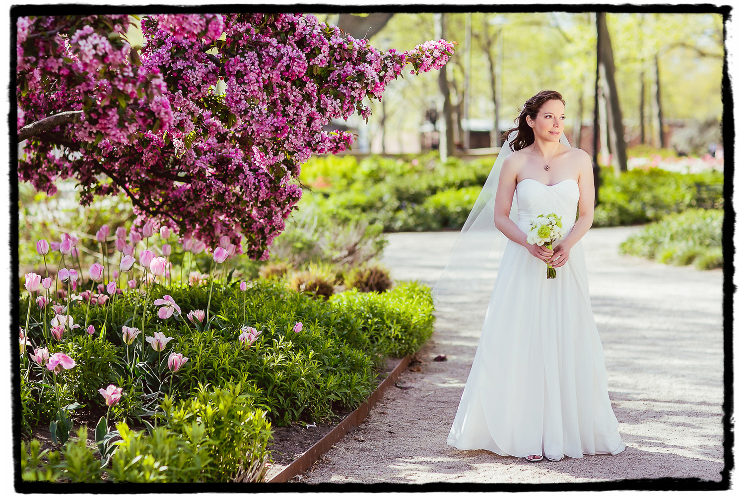 Julie looks lovely as she waits for a first look with her groom at Battery Gardens in Manhattan.