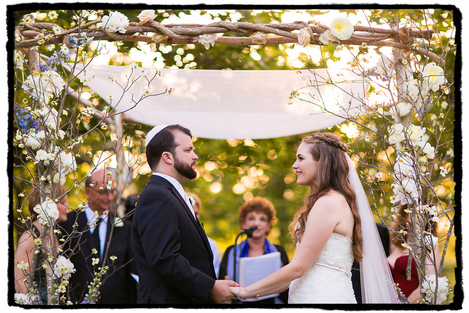 Alex & Will tie the knot under a floral Chuppah by Rebecca Sheperd at The Palm House at Brooklyn Botanic Garden.