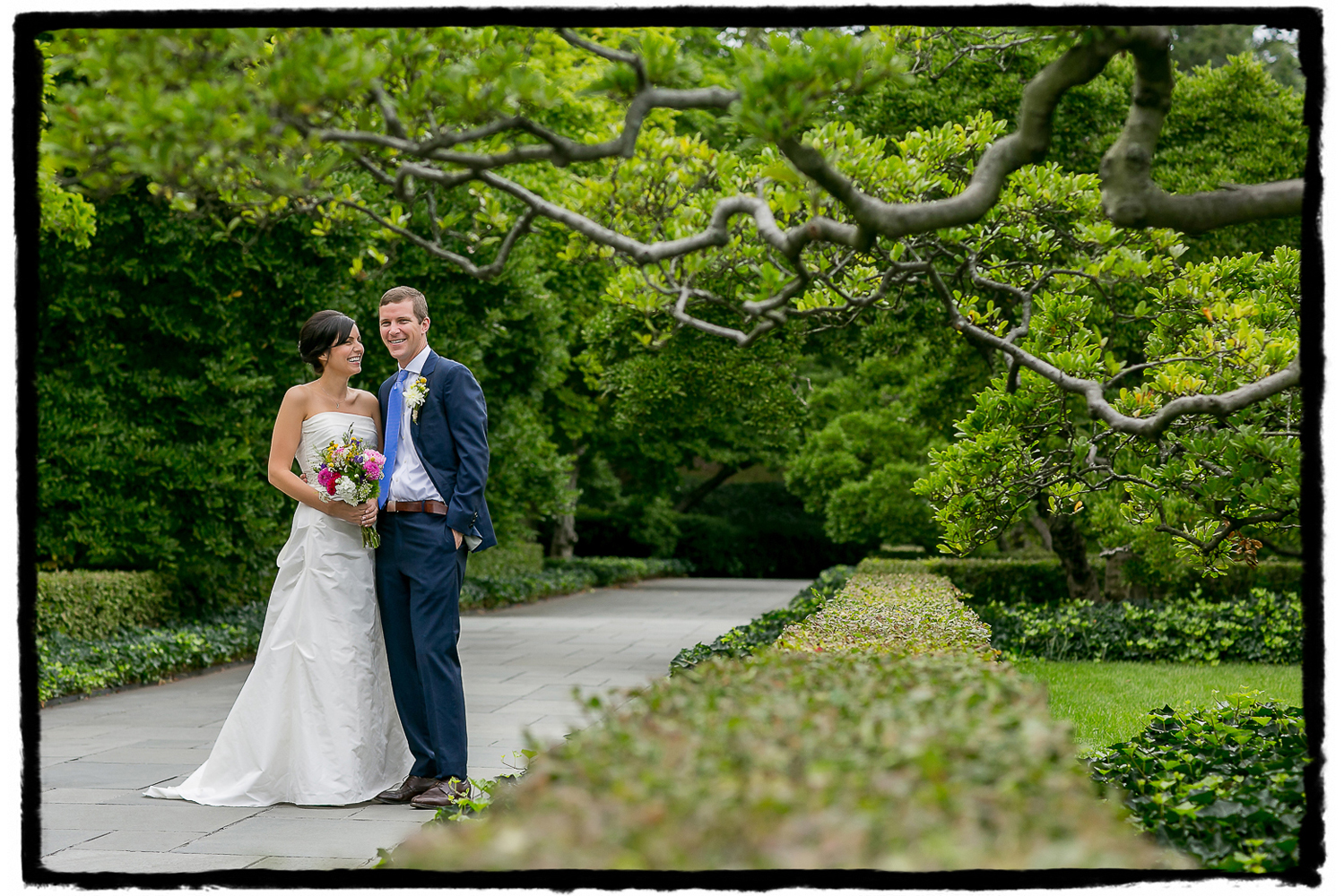 Angela and Dave are framed with greenery of the Brooklyn Botanic Garden before they celebrated their reception at The Palm House.